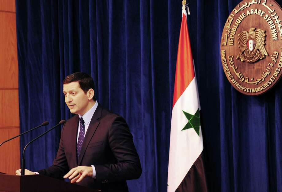 "A handout picture released by the official Syrian Arab News Agency (SANA) shows  Syria's Foreign Ministry Spokesman Jihad Makdissi addressing a news conference in Damascus  on July 23, 2012. Makdissi admitted that Syria possesses chemical weapons and said it would use them if attacked by foreign powers though not against its own people, in a warning that comes amid growing international concern that Damascus is preparing to deploy its chemical arsenal in the repression of a 16-month uprising against President Bashar al-Assad. AFP PHOTO / HO-SANA  == RESTRICTED TO EDITORIAL USE - MANDATORY CREDIT ""AFP PHOTO / HO / SANA"" - NO MARKETING NO ADVERTISING CAMPAIGNS - DISTRIBUTED AS A SERVICE TO CLIENTS ==-/AFP/GettyImages Photo: -, AFP/Getty Images / AFP"