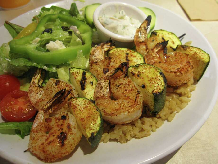 Shrimp kebabs are seasoned with paprika at Zoës Kitchen. Photo: Jessica Elizarraras, San Antonio Express-News