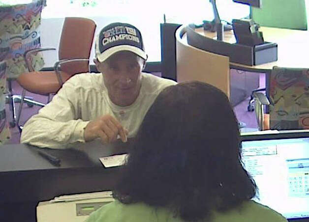 A bank surveillance camera shows a man police said is Albert Gebeau robbing the TD Bank on Madison Avenue in Bridgeport, Conn. on Friday, July 27, 2012. Photo: Contributed