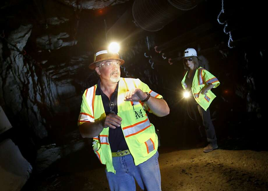 David Cochrane and Leanne Baker inspect a mine in Sutter Creek in Amador County, one of several in the Gold Country being reopened. See story, Page E5. Photo: Brant Ward, The Chronicle