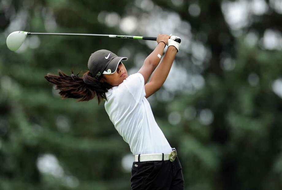 Faith Garcia, of Stamford, tees off during the Borck Memorial Golf Tournament Wednesday, August 1, 2012 at Mill River Country Club in Stratford, Conn. Photo: Autumn Driscoll / Connecticut Post