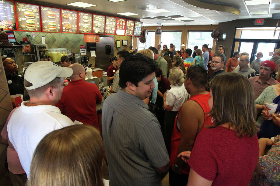 A crowd lines up at the counter of the Chick-fil-A restaurant on Loop 410 near McCollough during the lunch hour Wednesday August 1, 2012. Many of the customers were there to show their support for the restaurant's leadership that recently voiced its disapproval of same sex marriage. Photo: John Davenport, San Antonio Express-News / San Antonio Express-News