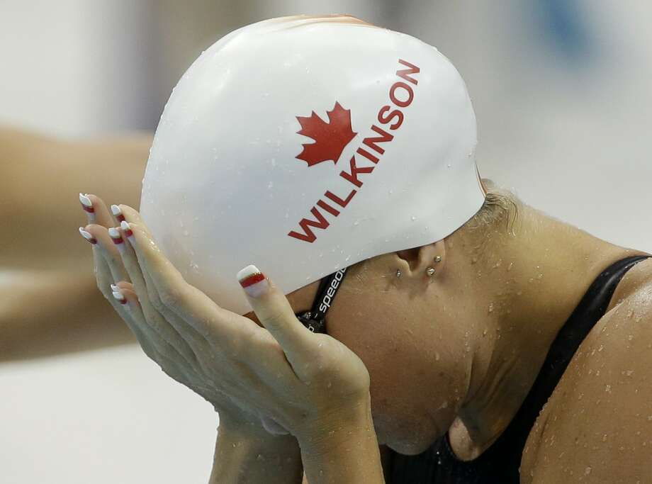 Canada's Julia Wilkinson reacts after competing in a women's 100-meter freestyle swimming heat  at the Aquatics Centre in the Olympic Park during the 2012 Summer Olympics in London, Wednesday, Aug. 1, 2012. (AP Photo/Lee Jin-man) (Associated Press)