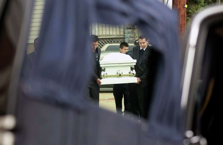 Pallbearers carry a casket to a hearse in front of the Madison Avenue Baptist Church in Paterson, N.J. on Wednesday, Aug. 1, 2012, after funeral services for a Peruvian brother and sister and their grandmother. Photo: Mel Evans, Associated Press / AP