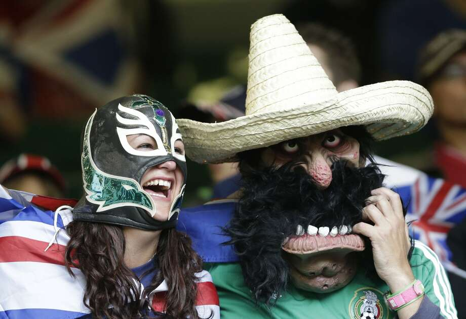 Mexican supporters are seen during the men's group B soccer match between Mexico and Switzerland, at the Millennium stadium in Cardiff, Wales, at the 2012 London Summer Olympics, Wednesday, Aug. 1, 2012. (Luca Bruno / Associated Press)