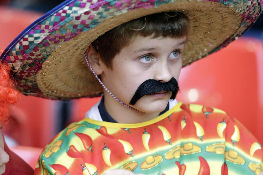 A Mexican supporter looks on during the men's group B soccer match between Mexico and Switzerland, at the Millennium stadium in Cardiff, Wales, at the 2012 London Summer Olympics, Wednesday, Aug. 1, 2012. (Luca Bruno / Associated Press)