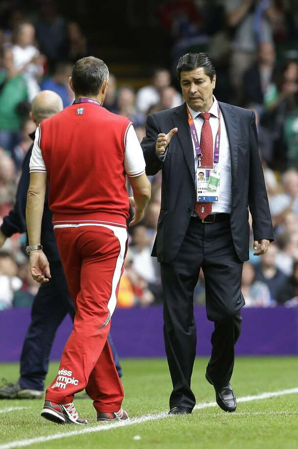 Mexico head coach Luis Fernando Tena, right, prepares to shake hands with Switzerland's head coach Pierluigi Tami, at the end the men's group B soccer match between Mexico and Switzerland, at the Millennium Stadium in Cardiff, Wales, at the 2012 London Summer Olympics, Wednesday, Aug. 1, 2012. Mexico won 1-0 and advances to the quarterfinals. (Luca Bruno / Associated Press)