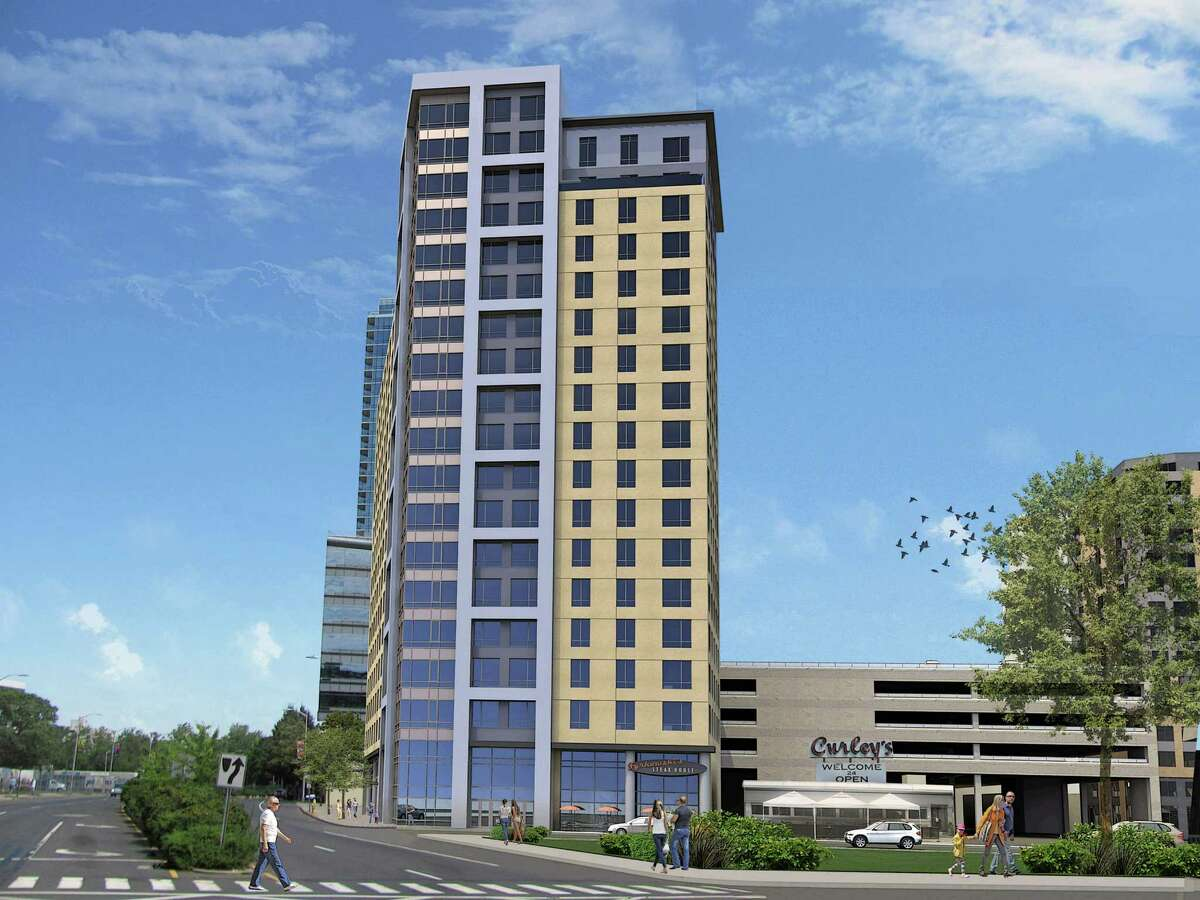 Artist rendering of a proposed 19-story, 207-unit apartment building at the corner of Washington Boulevard and West Park Place.