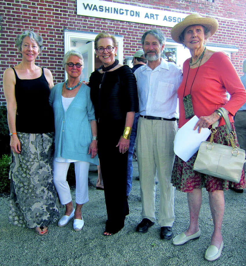 Enjoying the spotlight are, from left to right, Liz Dexheimer, Elizabeth MacDonald, Linda Allard, Marc Chabot and Georgia Middlebrook, during the reception for the Washington Art Association's 60th anniversary exhibit at its Bryan Memorial Plaza home in Washington Depot. July 14, 2012 Photo: Norm Cummings