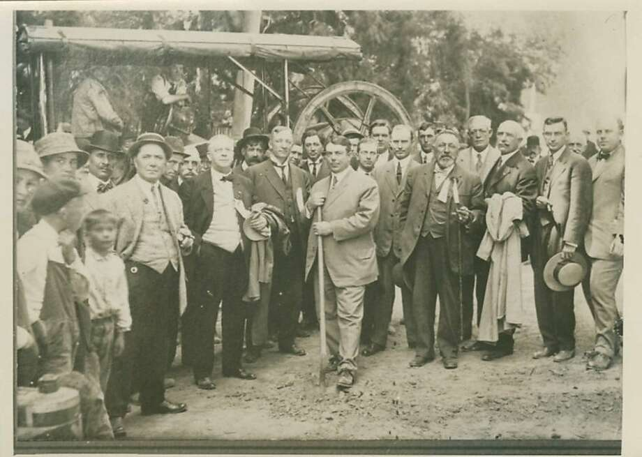 California Highway Commission Chairman Burton Towne, with a dozen other officials looking on, broke ground for the paving of El Camino Real near San Bruno Avenue in San Bruno 100 years ago this week. Photo: Caltrans Archive