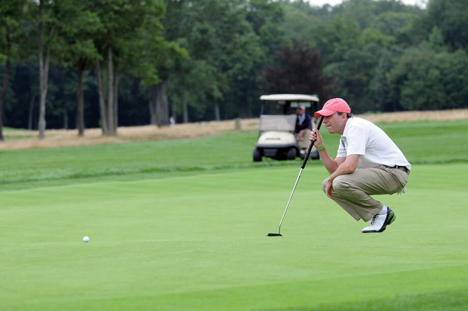 Jason Caron lines up a putt as he works toward winning the 78th Connecticut Open Championship at Wee Burn Country Club in Darien, Conn., August 1, 2012. Photo: Keelin Daly / Stamford Advocate