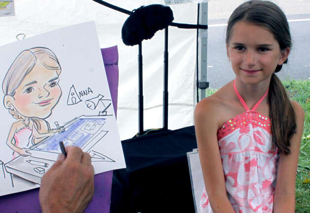 Caricature Art of Lebanon captures yet another image during the 45th annual New Milford Village Fair Days on the Village Green. July 28, 2012 Photo: Walter Kidd