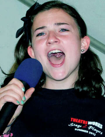 "Molly Street, 15, of New Milford takes the lead to sing ""Learn Your Lessons Well"" from ""Godspell"" as TheatreWorks Kids performs on stage during the Greater New Milford Chamber of Commerce's 45th annual Village Fair Days. July 27, 2012. Photo: Trish Haldin"