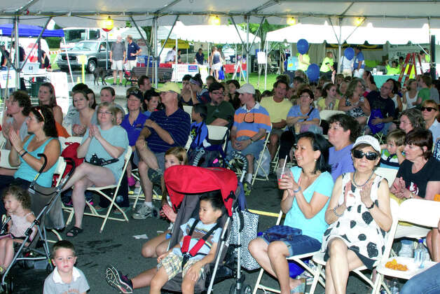 A large crowd relaxes under the entertainment tent during TheatreWorks Kids' performance at the Greater New Milford Chamber of Commerce's 45th annual Village Fair Days. July 27, 2012 Photo: Trish Haldin