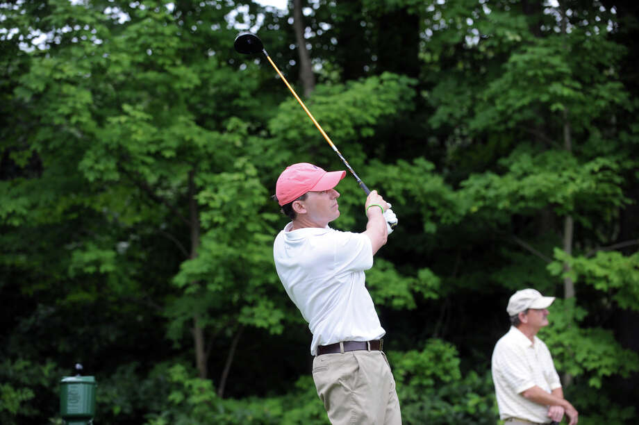 Jason Caron tees off on the eighteenth hole as he works toward winning the 78th Connecticut Open Championship at Wee Burn Country Club in Darien, Conn., August 1, 2012. Photo: Keelin Daly / Stamford Advocate