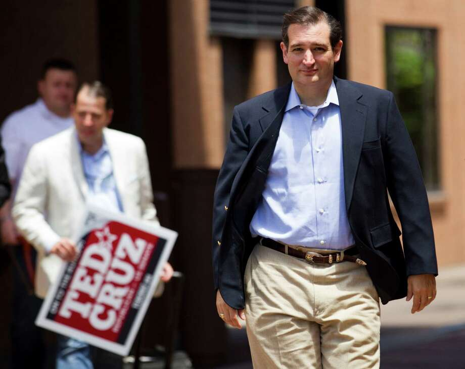 Ted Cruz, Republican candidate for U.S. Senate, walks across the parking lot at a hotel on his way to a news conference, the day after beating Lt. Gov. David Dewhurst in a runoff election, Wednesday, Aug. 1, 2012, in Houston. Cruz will face Democrat Paul Sadler in the November General Election. Photo: Brett Coomer, Houston Chronicle / © 2012 Houston Chronicle