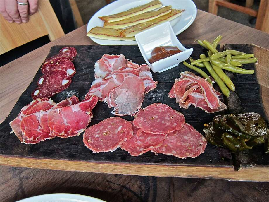 A house-cured salumi platter at Underbelly, clockwise from upper right: pancetta, finocchiona, coppa, wild boar sausage, lonza Photo: Alison Cook
