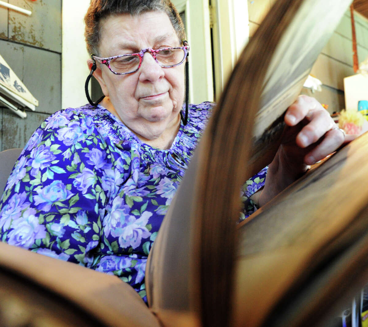 Stamford native Frances Flynn looks through a scrap book memorializing her father, Gustave Belasco WT 2nd Class, in her home in Stamford, Conn., July 30, 2012. Belasco was killed in the Guadalcanal battle during World War II, August 9 is the 70th anniversary of the battle.