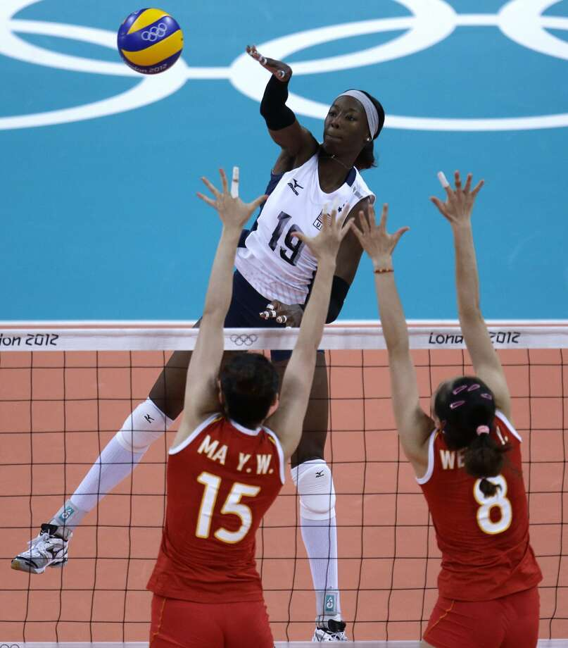 United States' Destinee Hooker (19) spikes over China's Ma Yunwen (15) and Wei Qiuyue during a women's preliminary volleyball match at the 2012 Summer Olympics, Wednesday, Aug. 1, 2012, in London. (Jeff Roberson / Associated Press)