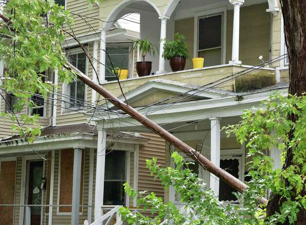 A fallen tree rests on power lines at a home on McClellan Street in Schenectady following a brief thunderstorm on Wednesday, Aug. 1, 2012.   (John Carl D'Annibale / Times Union) Photo: John Carl D'Annibale
