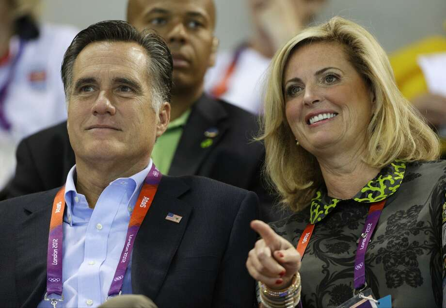 U.S. Republican presidential candidate Mitt Romney, left, and his wife Ann watch swimming heats at the Aquatics Centre in the Olympic Park. (AP Photo/Michael Sohn) (Michael Sohn / Associated Press)