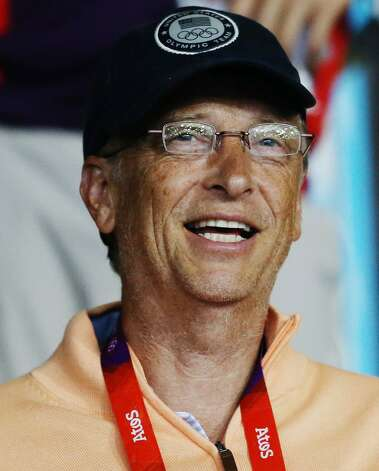 Microsoft founder Bill Gates watches Ariel Hsing of the United States play No. 2 seed Li Xiaoxia of China during their women's table tennis match at the 2012 Summer Olympics, Sunday, July 29, 2012, in London. (Sergei Grits / Associated Press)