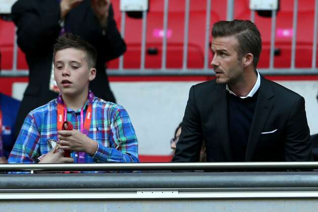 Footballer David Beckham (R) watches on during the Men's Football first round Group A Match between Great Britain and United Arab Emirates on Day 2 of the London 2012 Olympic Games at Wembley Stadium on July 29, 2012 in London, England.  (Photo by Julian Finney/Getty) (Julian Finney / Getty Images)