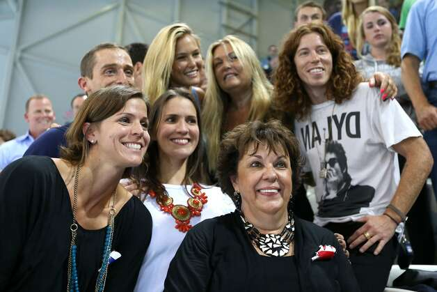 Debbie Phelps (C) the mother of Michael Phelps of the United States and his sisters Whitney Phelps (L) and Hilary Phelps (2nd L), snowboarder Shaun White of the United States and model Bar Refaeli (top C) pose on Day 4 of the London 2012 Olympic Games at the Aquatics Centre on July 31, 2012 in London, England.  (Photo by Ezra Shaw/Getty) (Ezra Shaw / Getty Images)