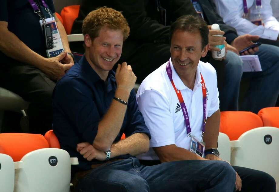 Prince Harry (L) watches the evening session on Day 5 of the London 2012 Olympic Games at the Aquatics Centre on August 1, 2012 in London, England.  (Photo by Alexander Hassenstein/Getty) (Alexander Hassenstein / Getty Images)