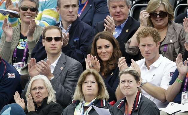 Britain's Prince William, left, his wife Kate Middleton the Duchess of Cambridge, center, and Prince Harry, right, watch the show-jumping phase of the equestrian eventing competition at the 2012 Summer Olympics, Tuesday, July 31, 2012, at Greenwich Park in London. (Markus Schreiber/AP) (Markus Schreiber / Associated Press)