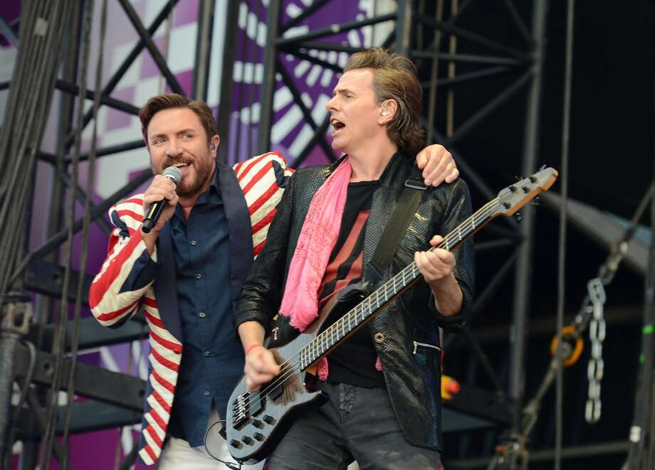 British singer Simon Le Bon (L) and guitar player John Taylor from the band Duran Duran perform on stage during the BT London Live Concert at Hyde Park in London on July 27, 2012, to celebrate the opening ceremony of the London 2012 Olympic Games.  (Miguel Medina/Getty) (MIGUEL MEDINA / AFP/Getty Images)