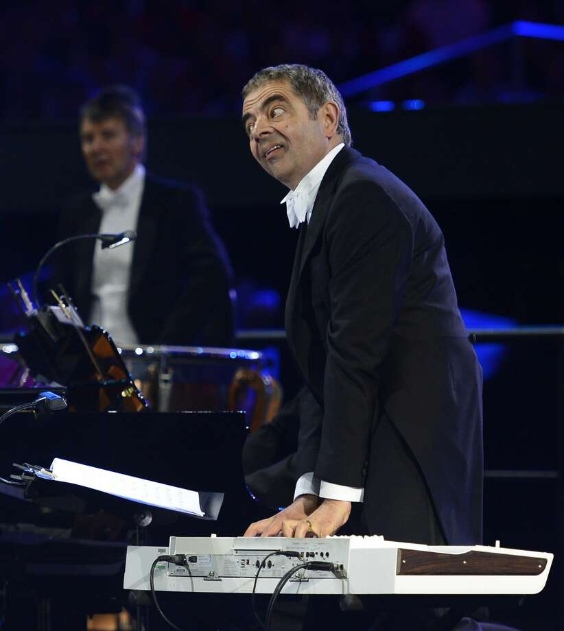 British actor Rowan Atkinson performs during the opening ceremony of the London 2012 Olympic Games on July 27, 2012 at the Olympic stadium in London. (Leon Neal/Getty) (LEON NEAL / AFP/Getty Images)