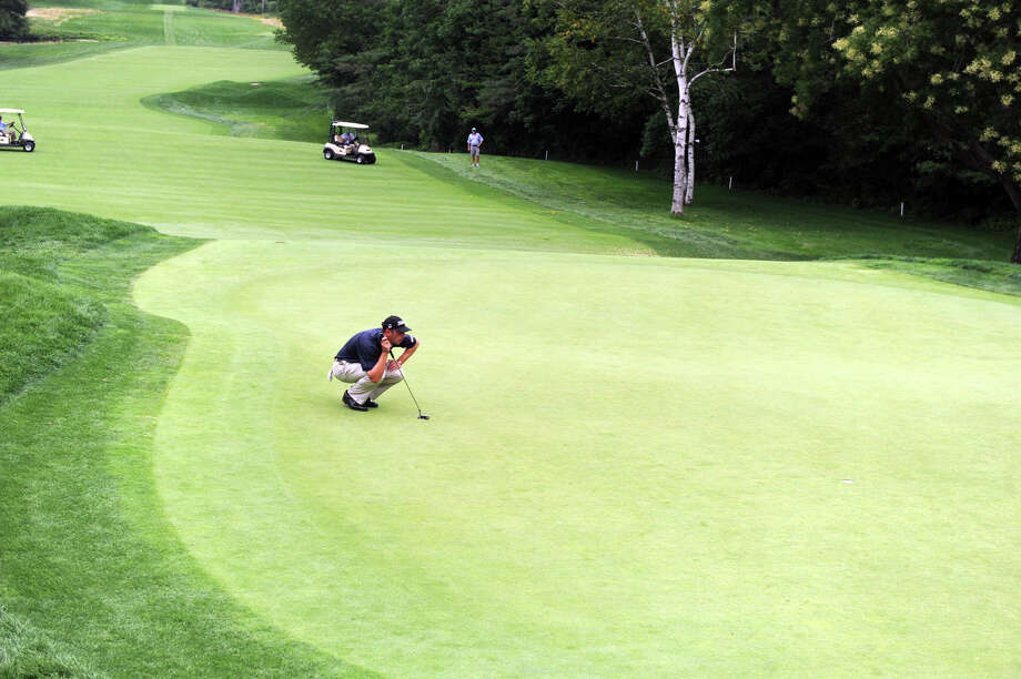 Danny Blain on the eighteenth green during the 78th Connecticut Open Championship at Wee Burn Country Club in Darien, Conn., August 1, 2012. Photo: Keelin Daly / Stamford Advocate
