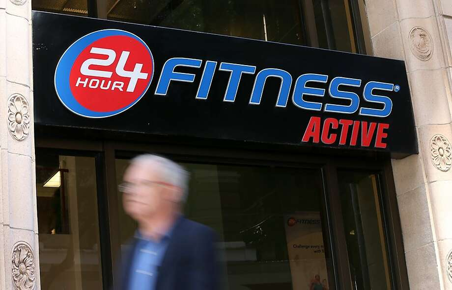 A pedestrian walks by a 24 Hour Fitness center in San Francisco on Tuesday. Photo: Justin Sullivan, Getty Images