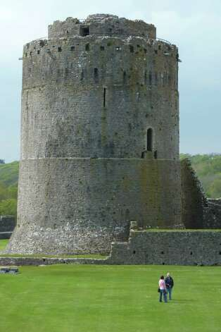 Pembroke Castle in the town of Pembroke is one of the many ancient ruins that dot the landscape in South Wales and that are easy to get to from the coast walking path. Photo: Spud Hilton / The Chronicle