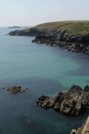 The Pembrokeshire Coastal Path is the best way (and sometimes the only way) to experience the most dramatic portions of Wales' rugged coast, including this portion on St. Non's Bay. Photo: Spud Hilton / The Chronicle