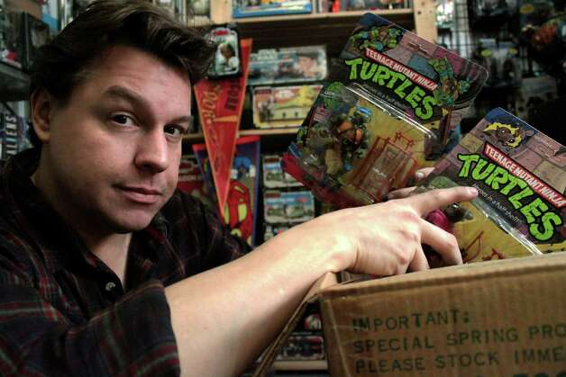"In this publicity image provided by the Travel Channel, toy hunter Jordan Hembrough unpacks a box of the original ""Heroes on the Half Shell"" from Teenage Mutant Ninja Turtles. ""Toy Hunter"" premieres on the Travel Channel on August 15, 2012. (AP Photo/Travel Channel, Elizabeth Fraser) Photo: Elizabeth Fraser, Associated Press / Travel Channel"