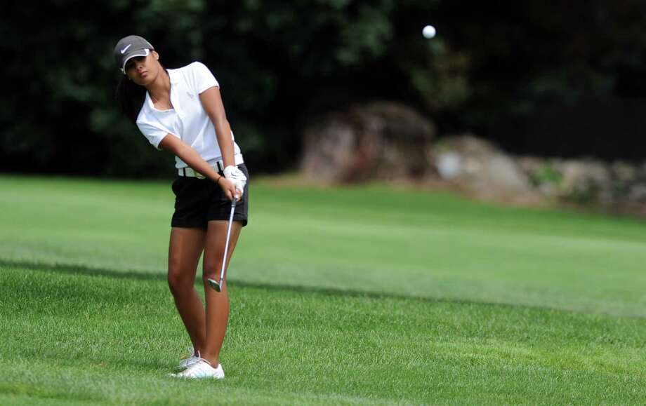 Faith Garcia, of Stamford, competes in the Borck Memorial Golf Tournament Wednesday, August 1, 2012 at Mill River Country Club in Stratford, Conn. Photo: Autumn Driscoll / Connecticut Post