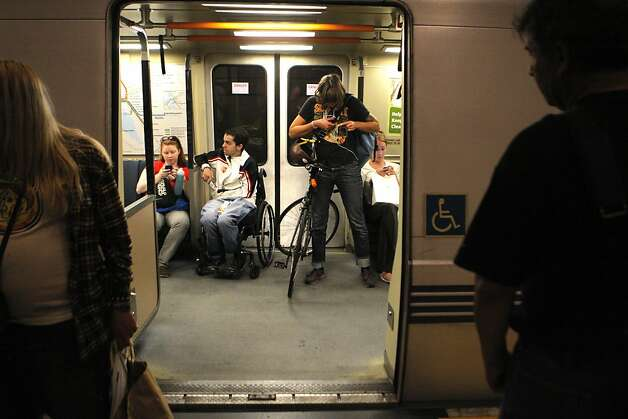 Commuter Evelyn Davis is seen on BART with her bicycle at the 24th Street Station on Tuesday, July 31, 2012, in San Francisco, Calif. Photo: Megan Farmer, The Chronicle