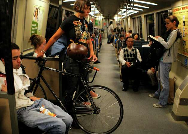 Commuter Evelyn Davis is seen on BART between Civic Center and 16th and Mission Streets with her bicycle on Tuesday, July 31, 2012, in San Francisco, Calif. Photo: Megan Farmer, The Chronicle