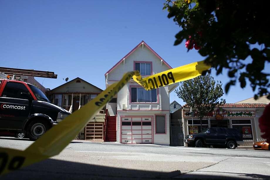 A police line tape is left behind, Wednesday Aug. 1, 2012, along the   3200 block of San Bruno Ave, where two people were shot last night, killing one and leaving the other in critical condition, in San Francisco, Calif. Photo: Lacy Atkins, The Chronicle
