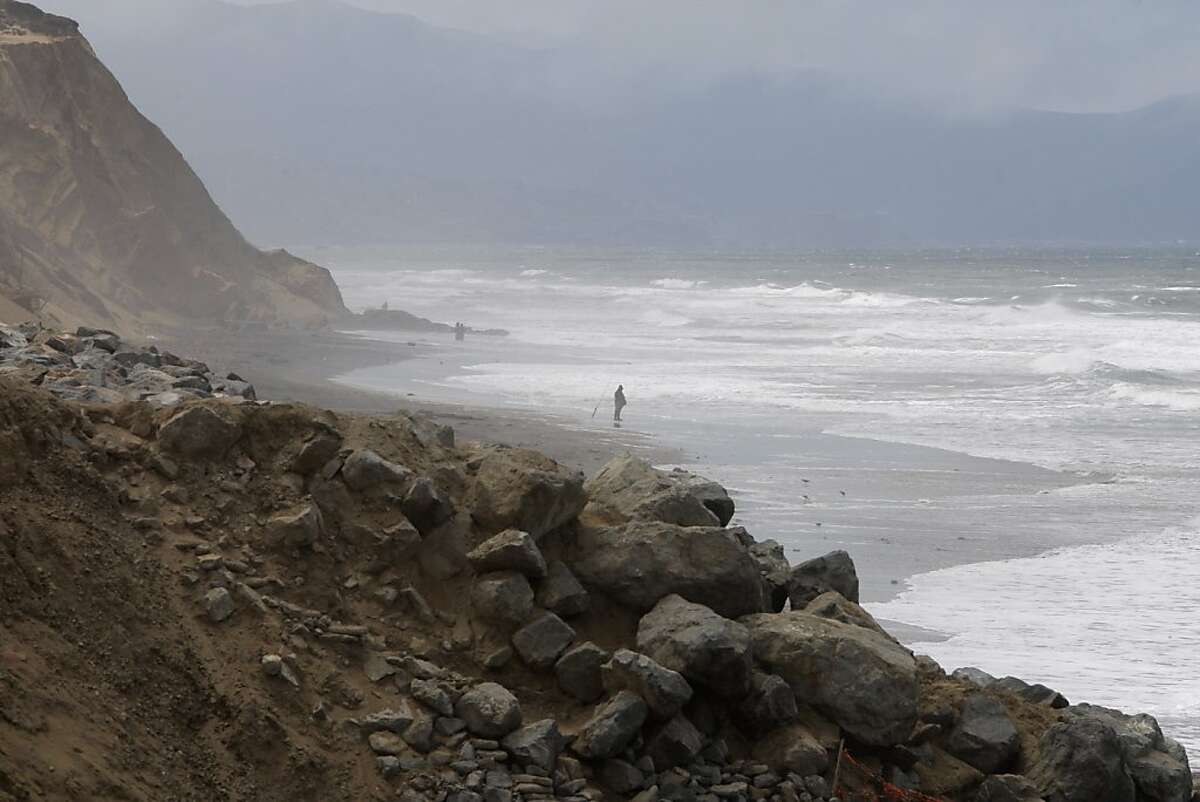 A fisherman is seen on Ocean Beach near the southbound stretch of the Great Highway between Sloat and Skyline boulevards which has been turned to one lane due to erosion, on Wednesday, August 1, 2012, in San Francisco, Calif.