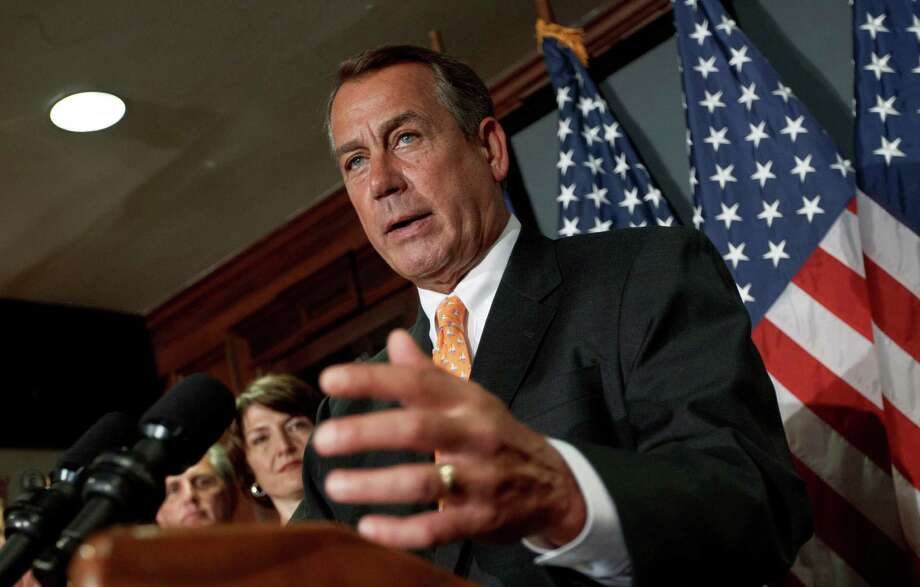 House Speaker John Boehner of Ohio, accompanied by fellow GOP leaders, meets with reporters at the Republican National Committee on Capitol Hill in Washington, Wednesday, Aug. 1, 2012.   (AP Photo/J. Scott Applewhite) Photo: J. Scott Applewhite / AP