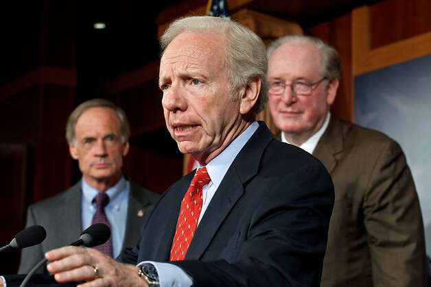 Sen. Joseph I. Lieberman, I-Conn., joined by Sen. Jay Rockefeller, D-W.V., right, and Sen. Tom Carper, D-Del., left, to announce that the Senate will take up legislation later this week to protect critical U.S. industries and other corporate networks from cyberattacks and electronic espionage, at the Capitol in Washington, Tuesday, July 24, 2012. (AP Photo/J. Scott Applewhite) Photo: J. Scott Applewhite, Associated Press