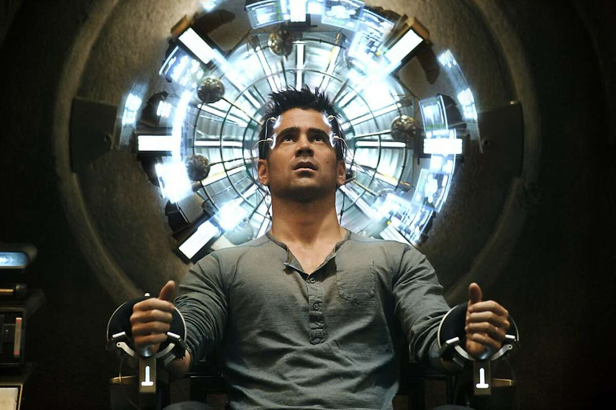 Colin Farrell's character sits in the Mind Trip Chair inside the Rekall Tripping Den in
