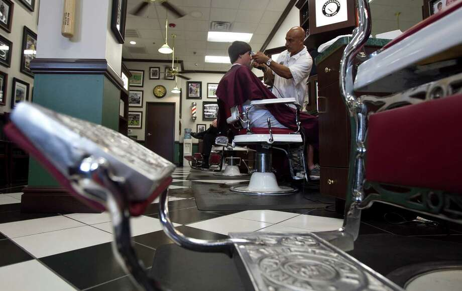 Ray Garcia (right) cuts Beau Brady's (left) hair at V's Barbershop Tuesday, Aug. 10, 2010, in Houston    James Nielsen  Chronicle Photo: James Nielsen / Houston Chronicle