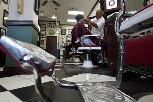 Ray Garcia (right) cuts Beau Brady's (left) hair at V's Barbershop Tuesday, Aug. 10, 2010, in Houston    James Nielsen  Chronicle