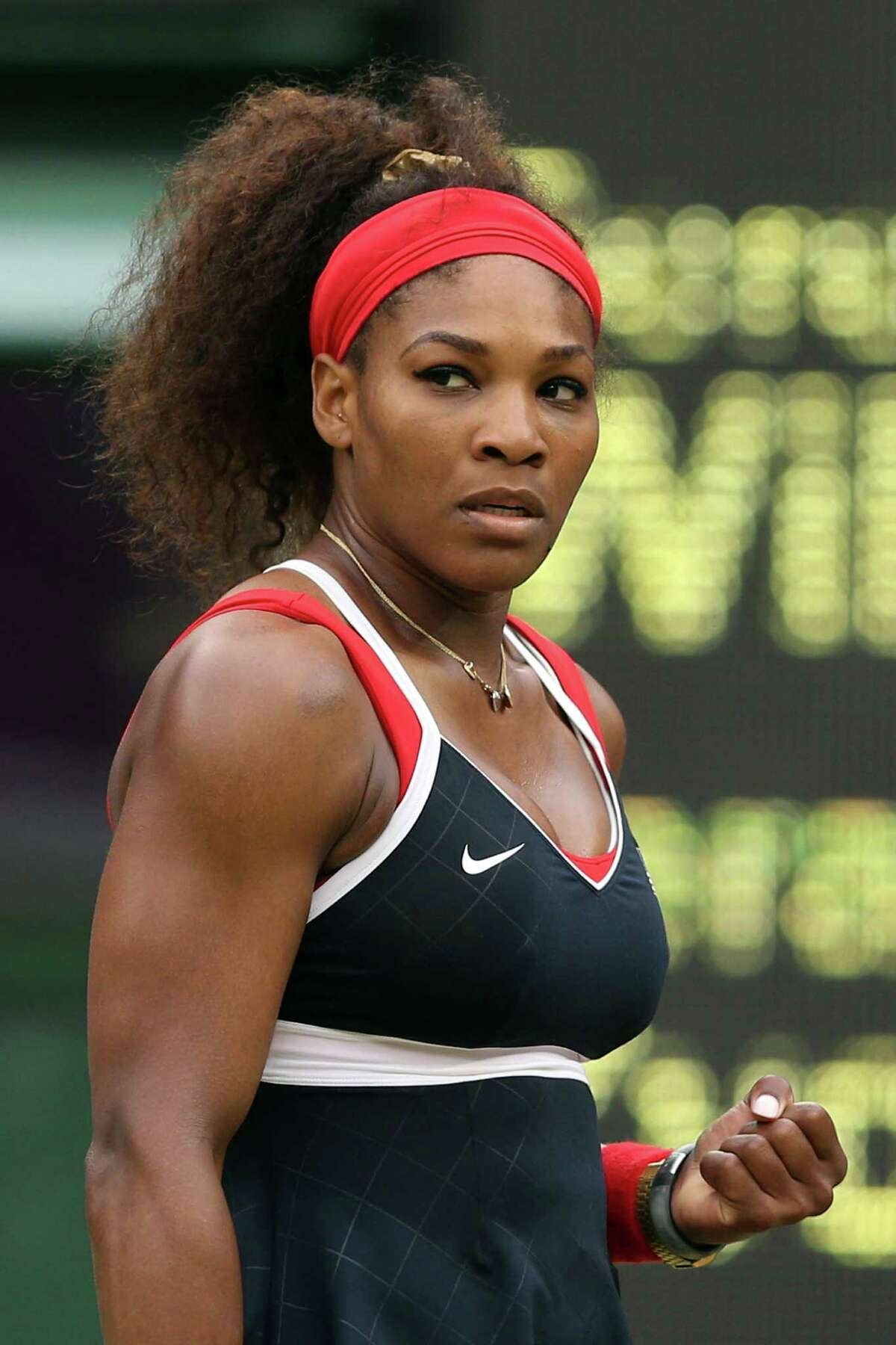 The biggest names in tennis, Serena Williams (above) and Roger Federer, both advanced to the quarterfinals Wednesday. The Wimbledon venue, however, is the bigger draw in these Olympics.