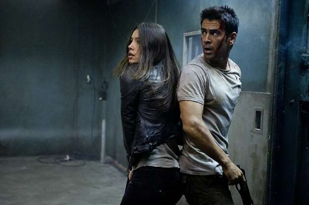 "Jessica Biel (left) and Colin Farrell star in ""Total Recall."" Photo: Michael Gibson, Columbia Pictures"