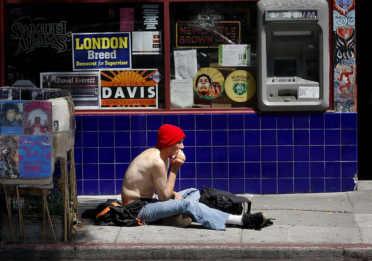 A man sits on Haight Street, who is later discovered to have a dislocated collar bone, and is taken away by paramedics. San Francisco's controversial sit lie law, which makes it against the law to sit or lie on a city sidewalk, is being enforced exclusively in the Haight Ashbury neighborhood.